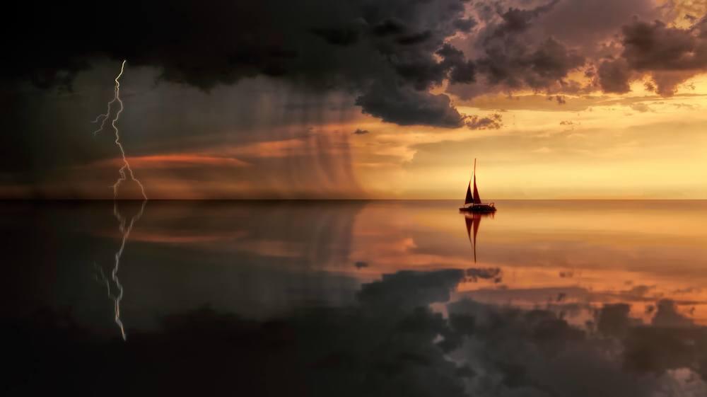 backlit-boat-clouds-1118874