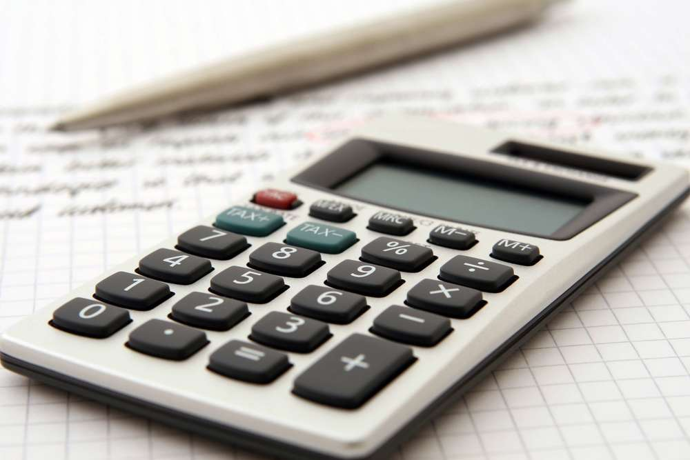 white-and-black-desk-calculator-on-white-graphing-paper-159804